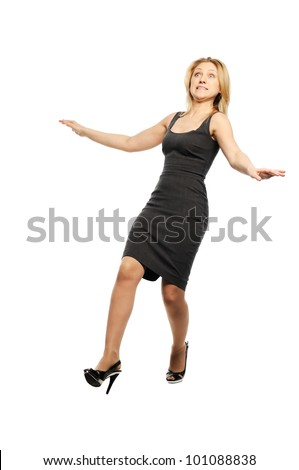 Beautiful young woman stands with falling back pose - stock photo