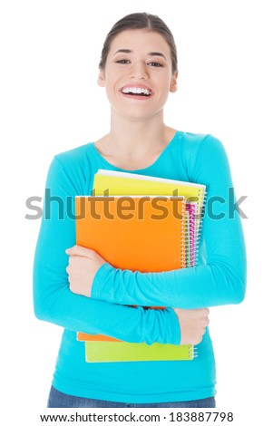 Beautiful young woman student with workbook. Isolated on white.  - stock photo