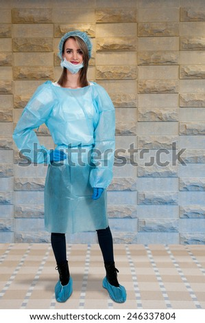 Beautiful young woman surgeon before performing a surgery - stock photo