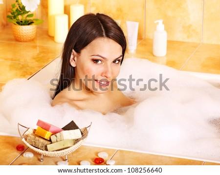 Beautiful young woman take bath. - stock photo