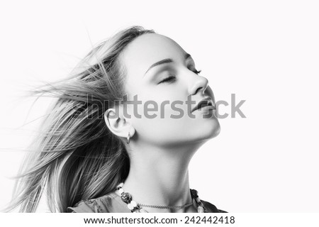 beautiful young woman takes a deep breath  - stock photo
