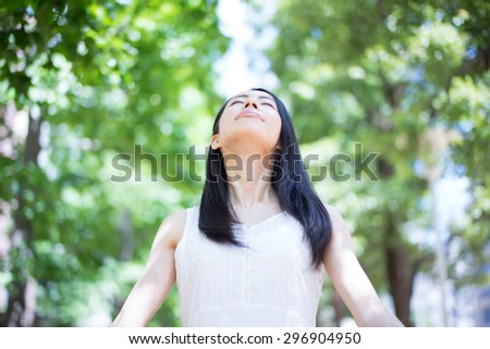 beautiful young woman taking a deep breath - stock photo