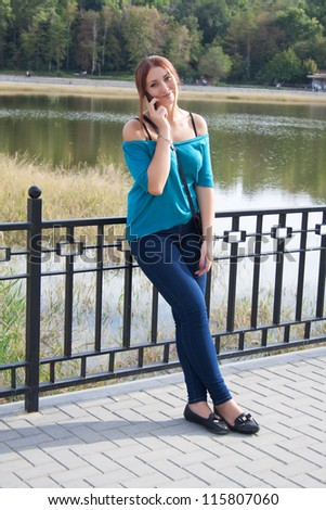 Beautiful Young Woman Talking on Mobile Phone - stock photo