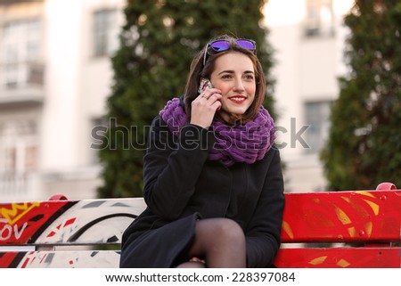 Beautiful young woman talking on the phone