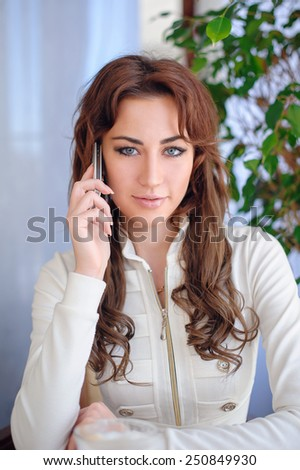beautiful young woman talking on the phone. - stock photo
