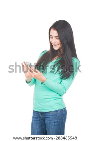 Beautiful young woman text messaging with her smart phone - stock photo