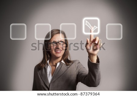 beautiful young woman touches the touch screen - stock photo