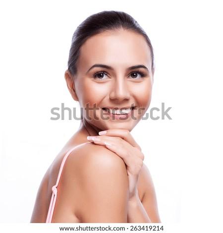 Beautiful Young Woman Touching Her Face.Fresh Healthy Skin. - stock photo