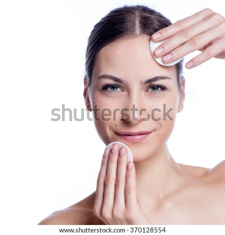 Beautiful Young Woman Touching Her Face.Fresh Healthy Skin.Isolated on White .  - stock photo