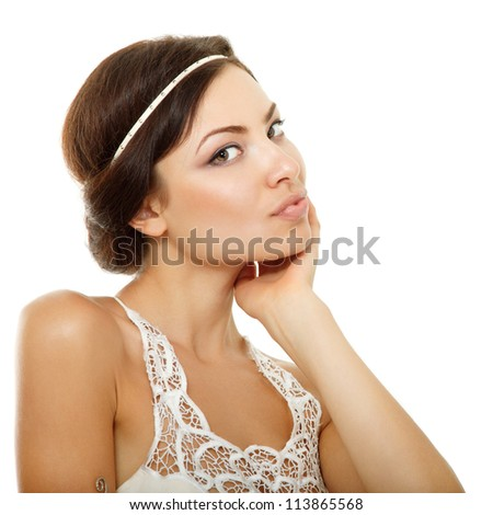 Beautiful young woman touching her face with hand and looking at camera. Isolated on white background - stock photo