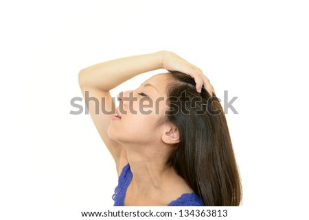 Beautiful young woman touching her hair