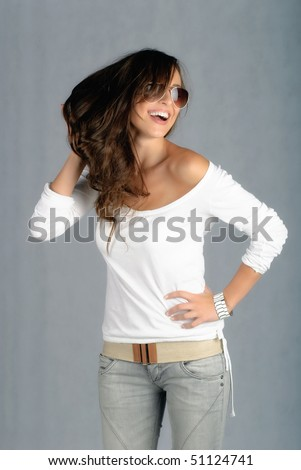 Beautiful young woman touching her hair and smiling