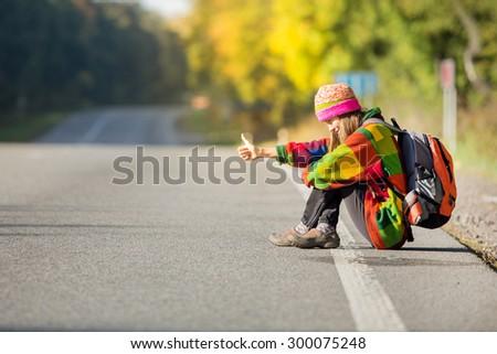 Beautiful young woman traveling - stock photo