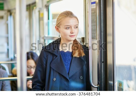 Beautiful young woman travelling in a train of Parisian underground - stock photo