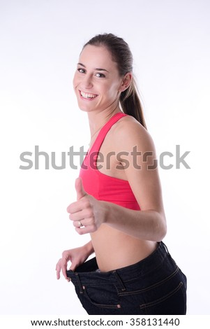 beautiful young woman trying pants after diet weight loss program - stock photo