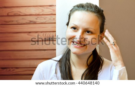 Beautiful young woman trying to remember something. Charming girl laughing at herself. - stock photo