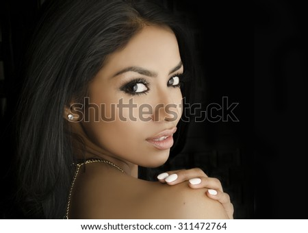 Beautiful young woman turning shoulder profile shot  - stock photo