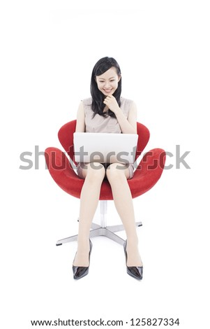beautiful young woman using laptop computer, isolated on white background - stock photo