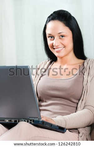 Beautiful young woman using laptop,Young woman with laptop - stock photo