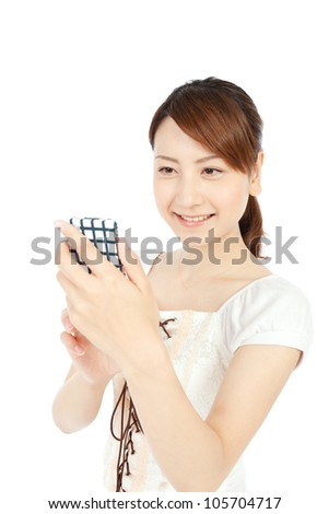 Beautiful young woman using mobile phone. Portrait of asian.