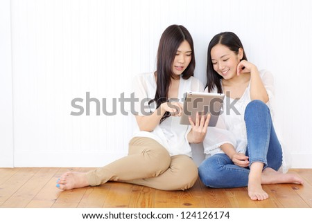 Beautiful young woman using tablet computer