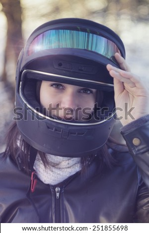 Beautiful young woman vintage photo, preparing for a ride. / Safety is the first / Beautiful young woman vintage photo, preparing for a ride.  - stock photo