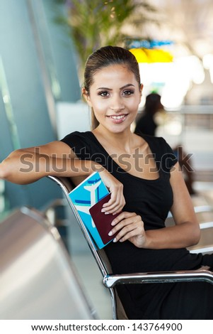 beautiful young woman waiting for flight at airport