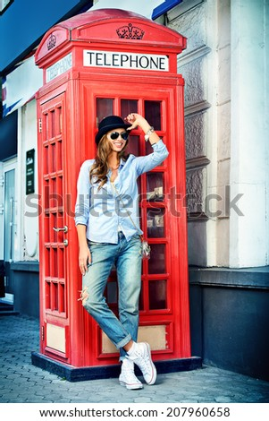 Beautiful young woman walking in the city. Europe, England. Vacation, tourist trip. - stock photo