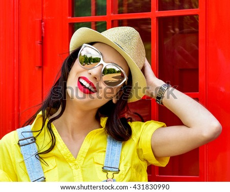 Beautiful young woman walking in the city. Europe, England. Vacation, tourist trip. Fashion woman in sunglasses outdoor. - stock photo