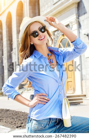 Beautiful young woman walking in the city. Fashion. - stock photo