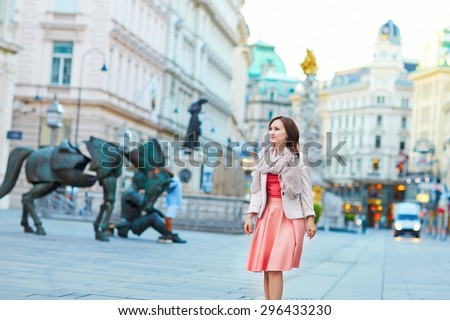 Beautiful young woman walking in Vienna, Austria - stock photo