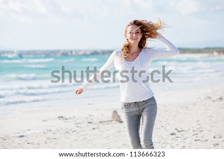 beautiful young woman walking on beach in summer vacation relaxing