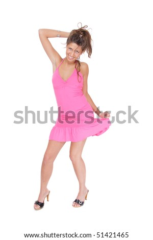 Beautiful young woman wearing a pink dress Isolated over white background