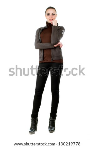 Beautiful young woman wearing black pants, shoes and sweater. Isolated on white - stock photo