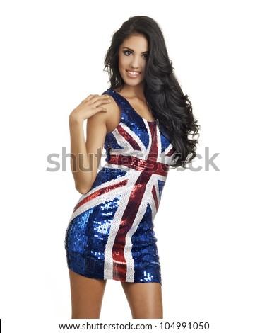Beautiful young woman wearing British flag union jack flag dress.  Image isolated against white. - stock photo