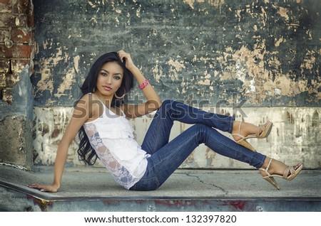 Beautiful young woman wearing denim jeans. - stock photo