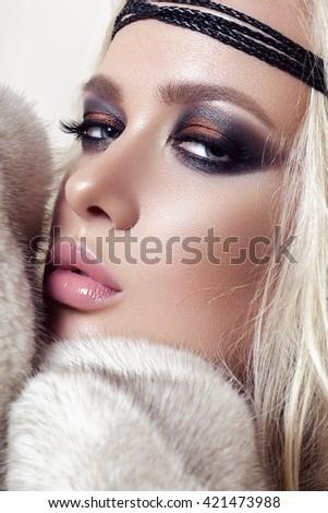 Beautiful Young Woman wearing Fur  - stock photo