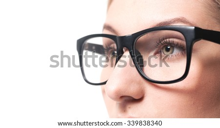 Beautiful young woman wearing glasses close-up. Isolated on white background. - stock photo