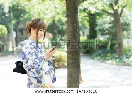 Beautiful young woman wearing japanese traditional kimono  - stock photo