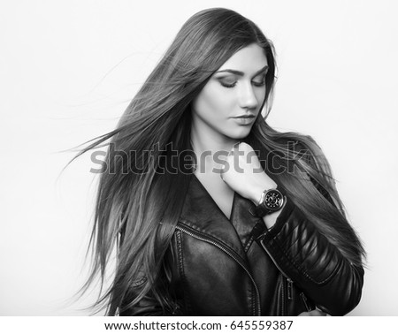 beautiful young woman wearing leather jacket and wrist watch