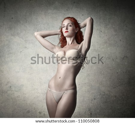 Beautiful young woman wearing lingerie - stock photo