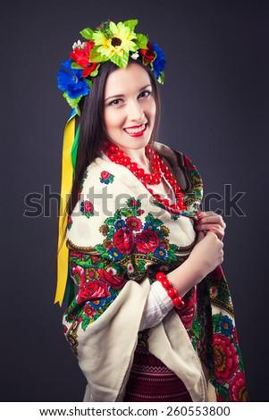 beautiful young woman wearing national ukrainian clothes  - stock photo