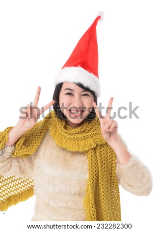 Beautiful young woman wearing santa hat with hand doing hand gesture of numbers counting - stock photo