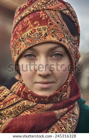 Beautiful young woman wearing scarf. Outdoor fashion portrait. /Scarf against the cold / Beautiful young woman wearing scarf. Outdoor fashion portrait.