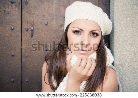 Beautiful young woman wearing white wool hat autumn portrait.