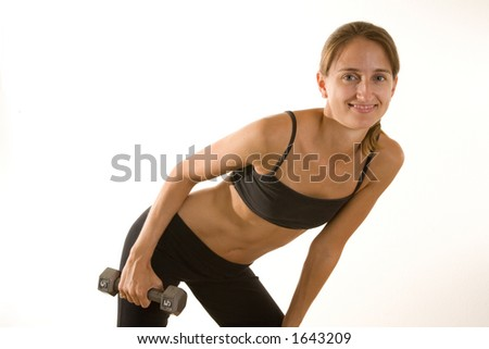Beautiful young woman wearing workout clothes and lifting weights. - stock photo