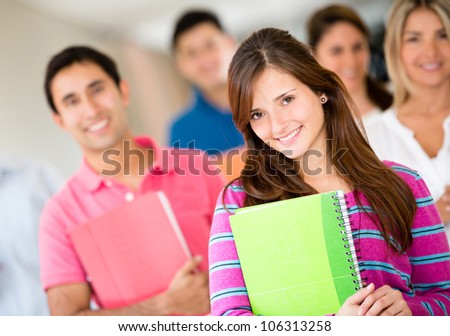 Beautiful young woman with a group of students