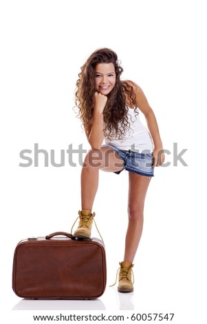 Beautiful young woman with a old suitcase, isolated on white background - stock photo