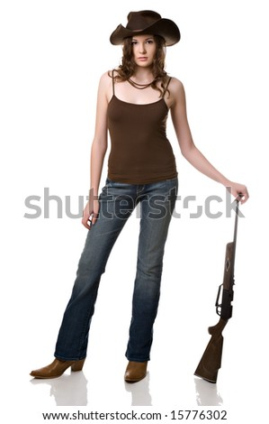 Beautiful young woman with a rifle and a cowboy hat isolated against a white background