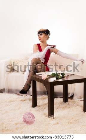 Beautiful young woman with a wine glass. Retro style - stock photo